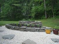 Two-level retaining wall flower bed made with flat stones