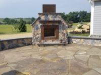 veneer fireplace and sitting walls, flagstone patio
