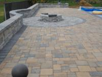 fire pit, sitting wall, pavers around pool, work in progress