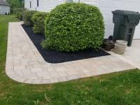 new paver walkway that has rounded corners