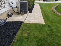 paver walkway and landscaped flower beds