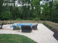 Cobblestone pavers surrounding pool and used for sidewalk with landscaped flower beds