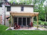 Patio made of brick pavers with pergola built over it