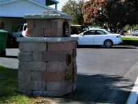 Concrete block column at end of driveway built for mailbox and newspaper holder