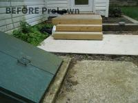 Wooden steps outside back door before landscaping design