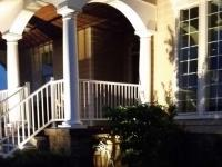 Exterior lights placed in the flower bed provide porch light