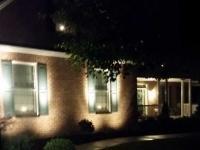 Outdoor light fixtures illuminating front walk